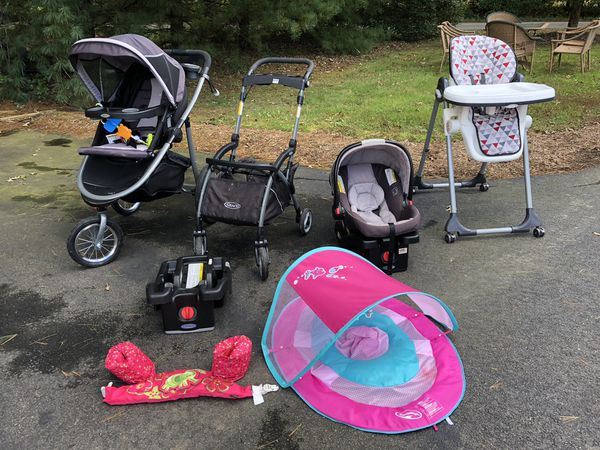 Car seat and high chair and two strollers
