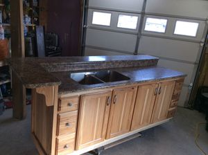 Custom built rustic hickory bar unit with integrated stainless steel sink ,soft close doors and drawers,seating for up to 6. Can be plumbed as an isl for Sale in Huntington, IN