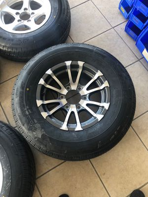 """Aluminum trailer rims with radial tire. 15"""" 6 lug. 225/75/15. New with warranty. for Sale in Plant City, FL"""
