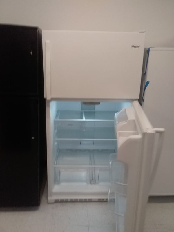 Whirlpool top and bottom refrigerator new scratch and dents good condition 6 months warranty