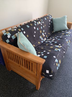 Solid Oak futon converts to full bed with newer cover for Sale in Bannockburn, IL