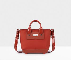 Hunter Military Red Leather & Rubber Midi Crossbody Tote for Sale in Humble, TX