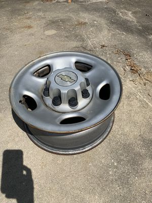 4 Chevy 8 lug steel wheel with all center caps for Sale in Ocean Isle Beach, NC