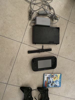 Nintendo Wii U system in good condition with two extra controllers and as game for Sale in Fort Lauderdale, FL