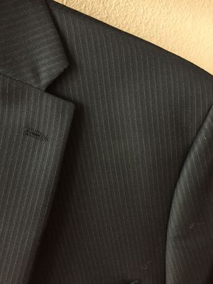 Michael Kors black with pinstripes young men's suit coat and pants. Beautiful and in great condition. Wedding or graduation for Sale in Mission Viejo, CA