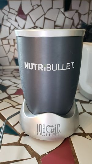 Nutribullet gray with 2 cups one with attached handle, second with removable handle. for Sale in Brooklyn Center, MN
