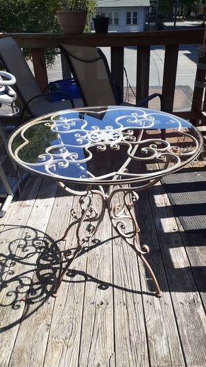 Ornamental antique glass top table for Sale in Charlotte, NC