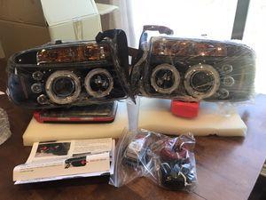 97-04 Dodge Durango/Dakota Angel Eye Halo & LED Projector headlights and LED tail lights for Sale in San Antonio, TX