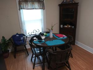 Kitchen table with chairs, table extensions, and hutch for Sale in Murfreesboro, TN
