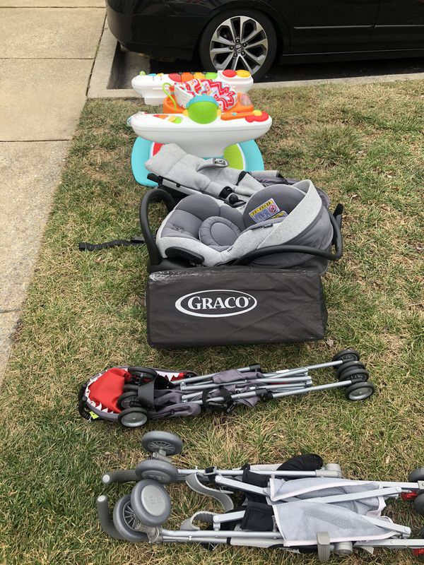 Stroller, Car seat with base, baby toys.