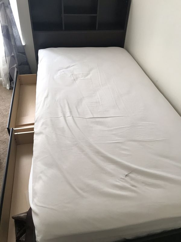Twin black bed with mattress