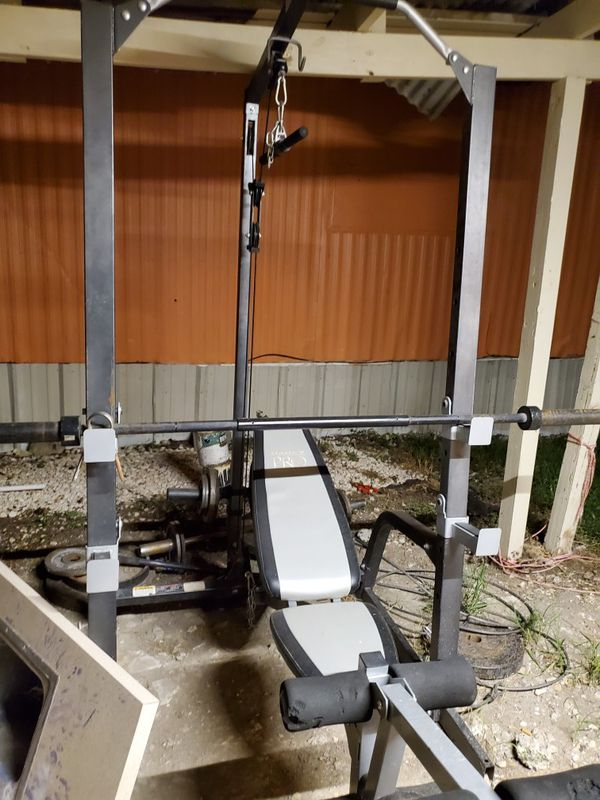 Mercy workout cage ,bar ,curl, weights, and bench