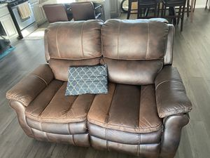 2 piece leather sofa. (Used). Electric recliners!! (Ashley brand) for Sale in Hayward, CA