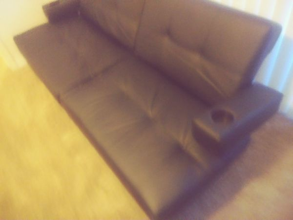Leather futon (very comfortable) like new$100
