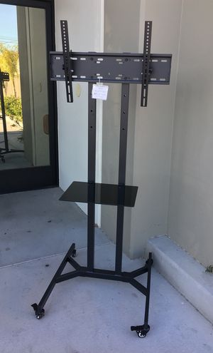 """New in box 28"""" depth x 26"""" wide x 65"""" tall 32 to 65 inch tv television hewvy duty stand with locking wheels and shelf for Sale in Santa Fe Springs, CA"""