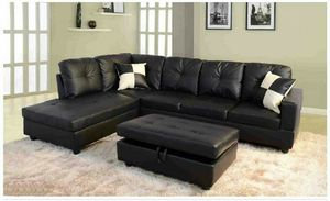 Black faux leather sectional with ottoman has storage ( new ) for Sale in Hayward, CA