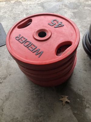 8 x 45 lbs rubber coated Olympic weight plates in very good condition for Sale in Ballwin, MO