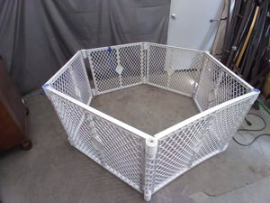 Six panel baby gate or dog kennel folds up for easy storage for Sale in Boise, ID