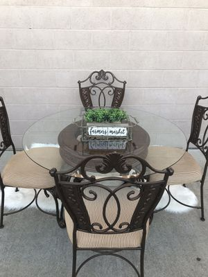 Brand new heavy cast iron glass dining room table and 4 extremely heavy chairs l will deliver for a fee for Sale in Lodi, CA