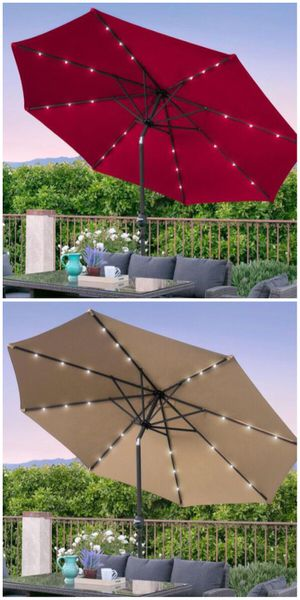 New in box large 10 feet diameter tilt adjustable crank open outdoor patio umbrella with solar powered LED lights waterproof sun shade canopy for Sale in Norwalk, CA