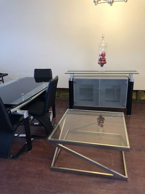 Glass dinning table with 4 chairs, glass cocktail table and glass 4 shelf buffet for Sale in Washington, DC