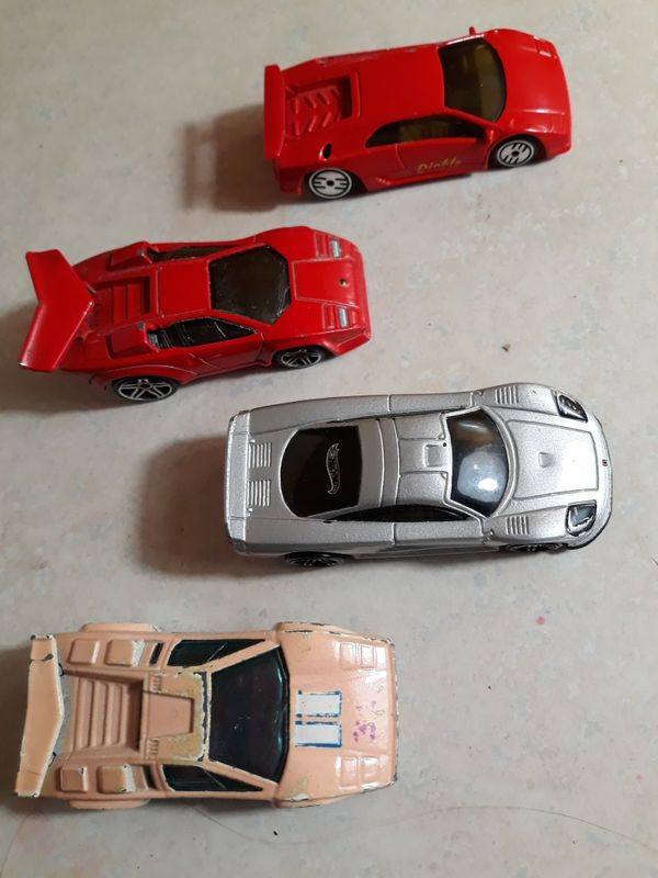 3 Lamborghini's and one is a Ford saleen S7