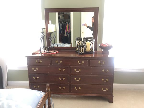 All wood bedroom furniture set. Bed, 2 dressers and two nightstands. In fantastic condition. Quality made furniture.