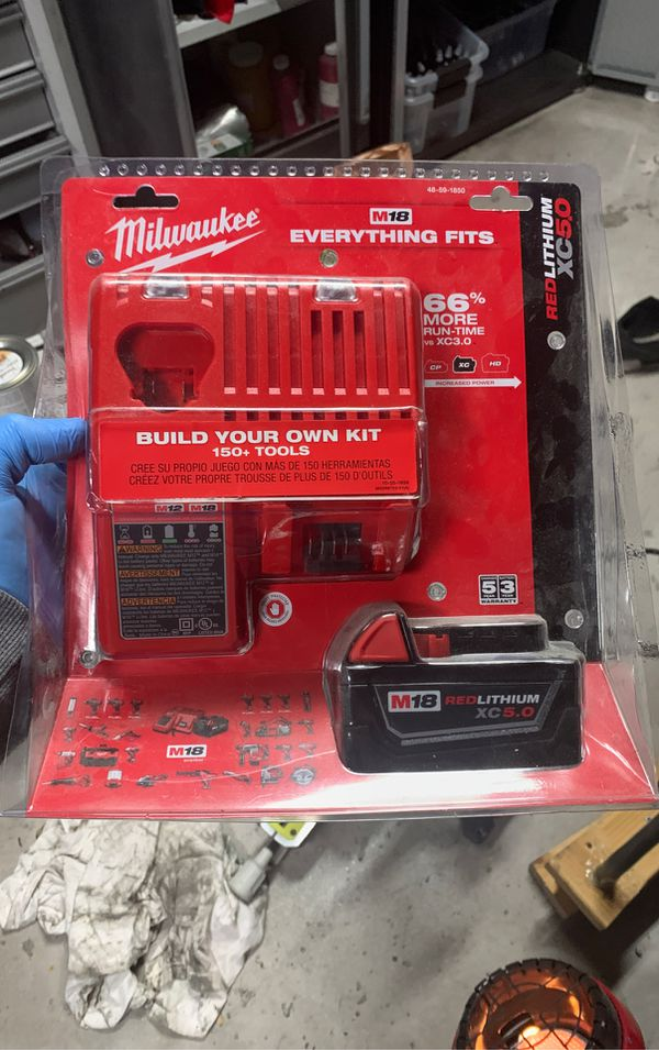 Milwuakee Milwaukee M18/M12 battery charger and 5.0 battery