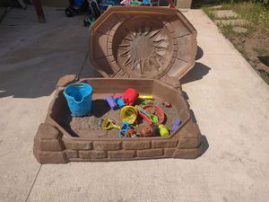 Kids sand box with toys can't go to the beach and play with sand no problems with this one 😁 for Sale in San Diego, CA