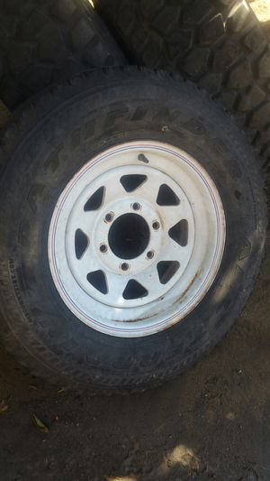 Have an extra spare 235/75/15 tire and wheel for a 6 lug trailer, good for spare will get you to your next stop, tire is weathered! for Sale in Montclair, CA