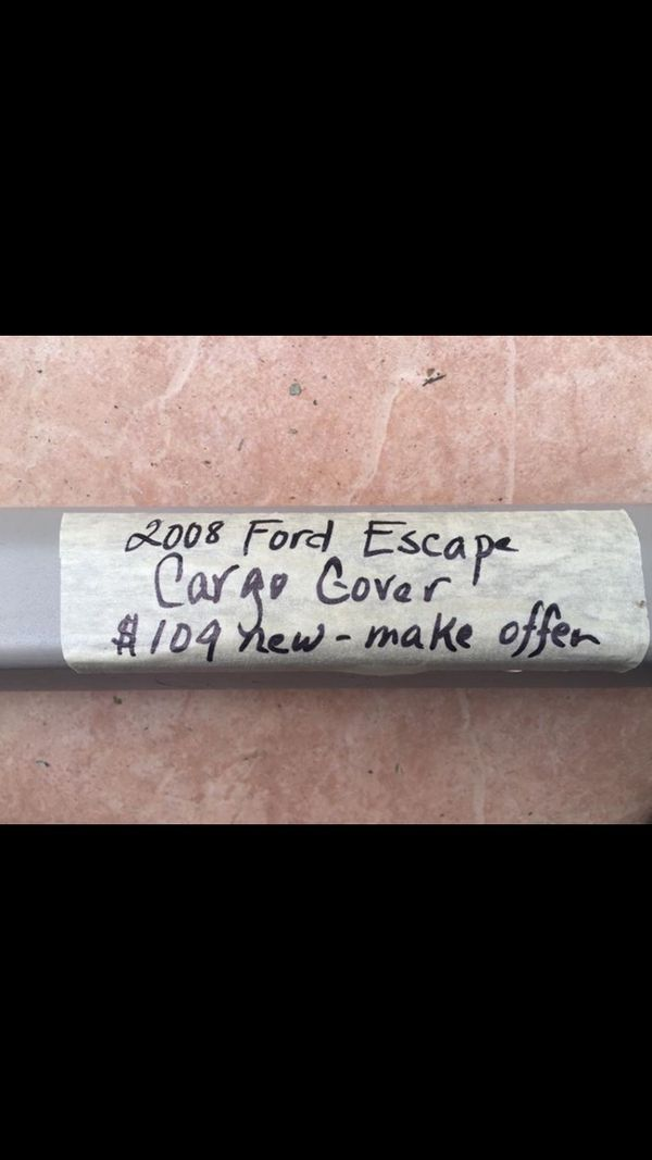 Cargo cover and 2 headrests for a 2008 Ford Escape. New 109.00