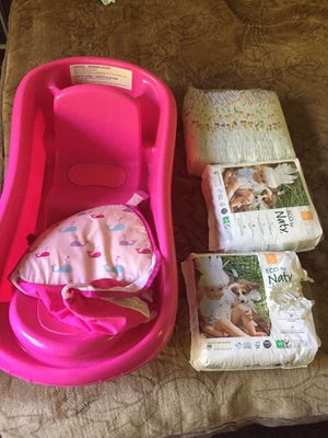 Bath tub for babies and size 5 diapers for Sale in San Francisco, CA