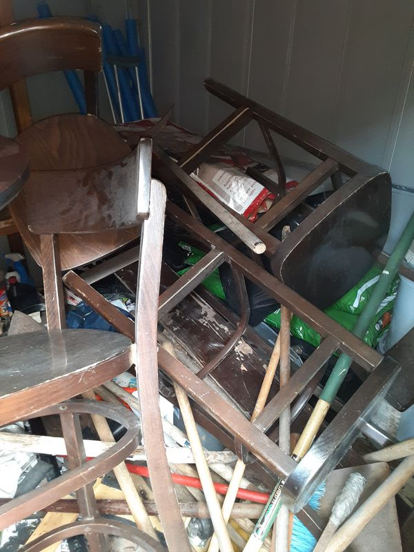 A group of bar tables and chairs for sale