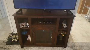 Rosewood tv stand,with glass main door looks good for Sale in Delray Beach, FL