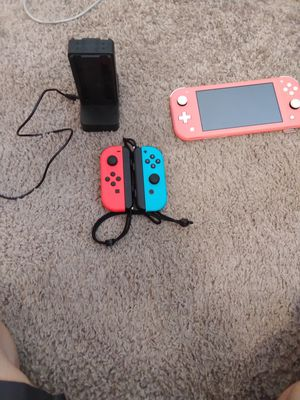 Nintendo Switch Lite and Charger the Joy Cons are sold for Sale in Rolla, MO