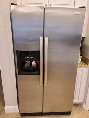 Whirlpool side-by-side refrigerator with ice maker for Sale in Tampa, FL
