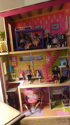 Three story barbie house with elevator that comes with 12 Barbie's and clothes and shoes. for Sale in Dunedin, FL