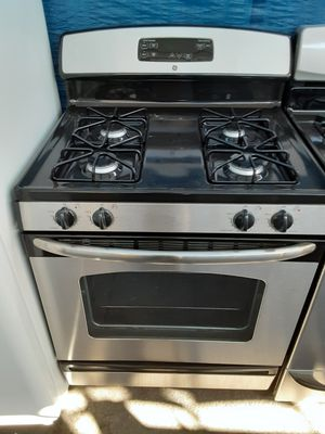 $399 GE stainless gas stove includes delivering the San Fernando Valley a warranty and installation for Sale in Los Angeles, CA