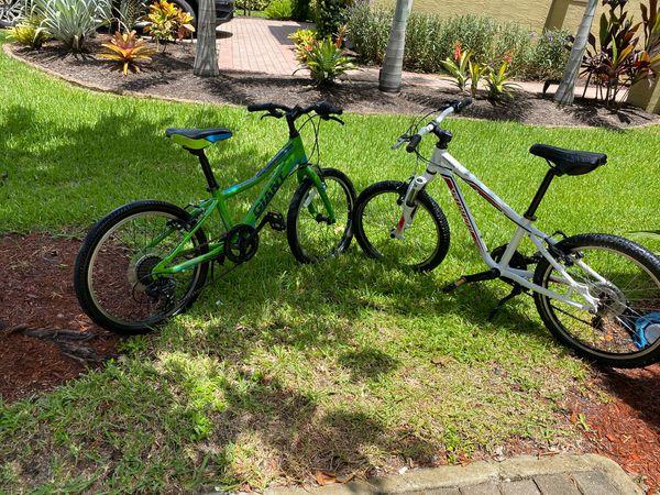 Green Giant XTC jr & White Specialized HotRock Bikes