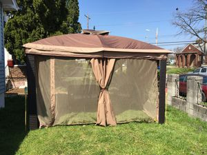 Way to start your holiday with family under this big beautiful canopy tent for Sale in Columbus, OH