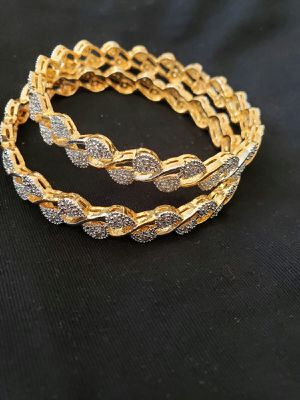 Ladies bangle golden with white zircone stone size 6.5 cm for Sale in Moreno Valley, CA