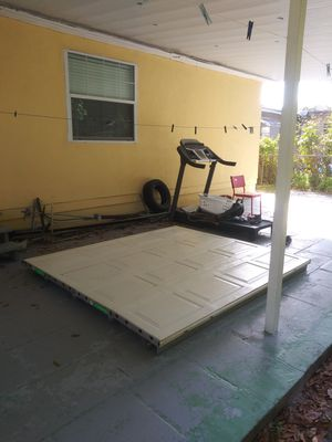 Garage door 7 by 8 very good condition it comes with everything including two remotes motor on the mount for Sale in Saint Petersburg, FL