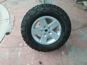 1 new Jeep wheel and new BFG ko2 tire 265/70/17 no separate sold together for Sale in Ontario, CA