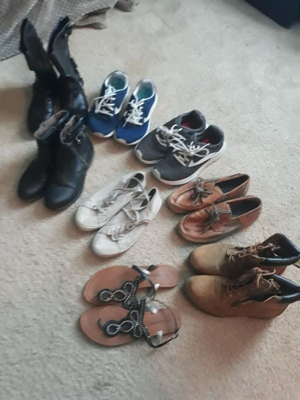 Women's boots, shoes, and a pair of sandals