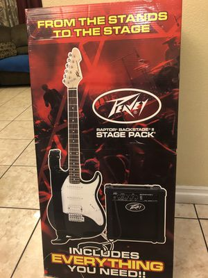 Peavey electric guitar package come with amplifier soft case strap cable tuner strings picks and dvd for Sale in South Gate, CA