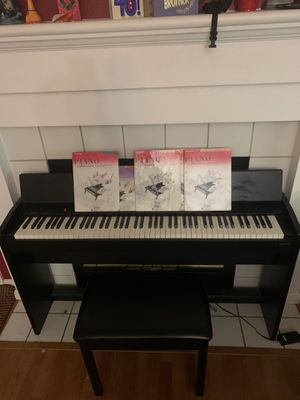 Piano For Sale!! Only 400!! Also Comes with books and chair for Sale in Roseville, CA