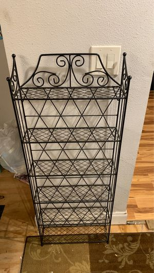 Large DVD metal rack with back for Sale in Kissimmee, FL