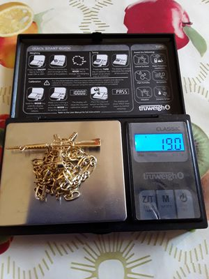 Gold Figaro Chain with Pendant for Sale in Phoenix, AZ