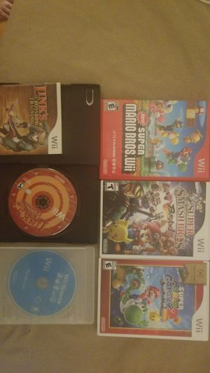 Wii games, game cube controller and wii steering wheels for Sale in Quincy, IL