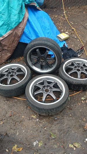 4 black rims with 4 tires about 70 percent good for Sale in Portland, OR